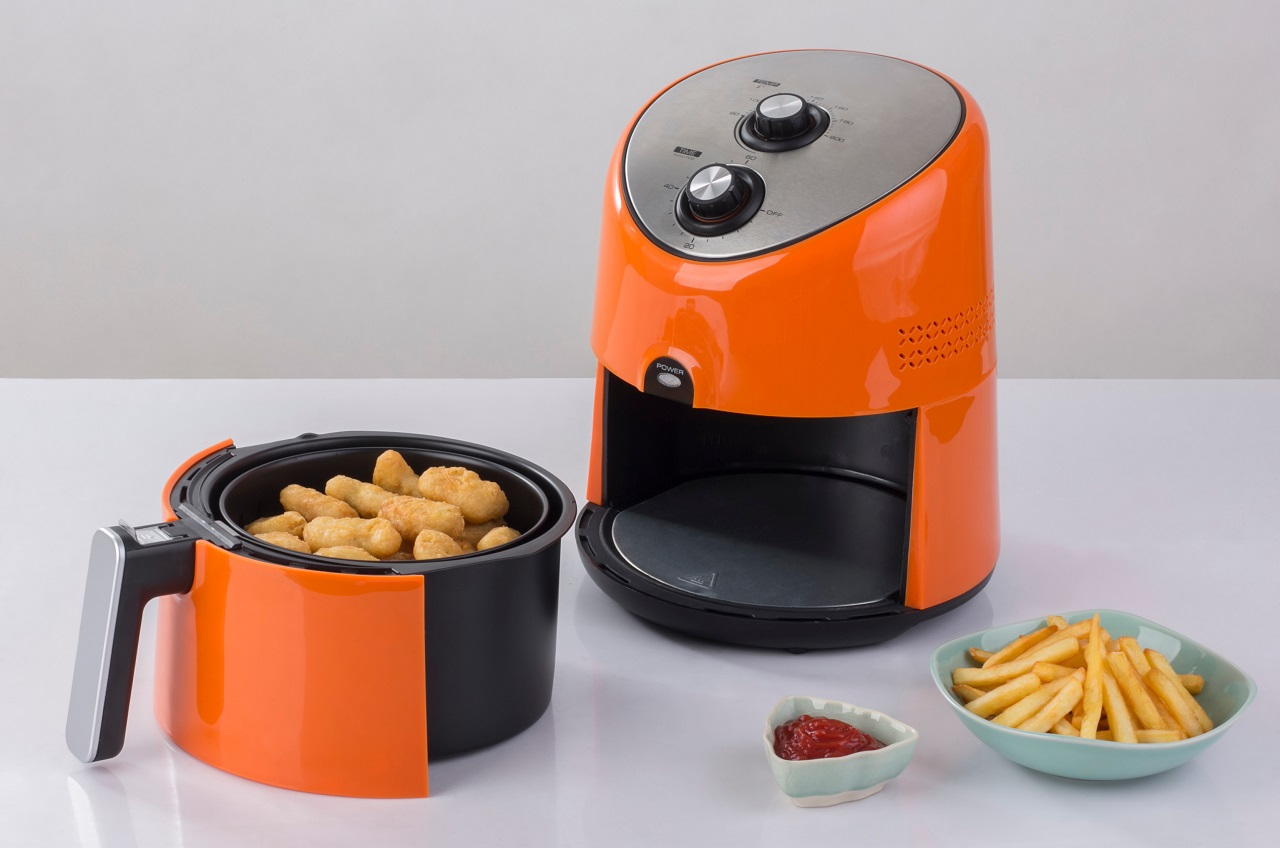 Air-fryer-machine-with-chicken-and-french-fried