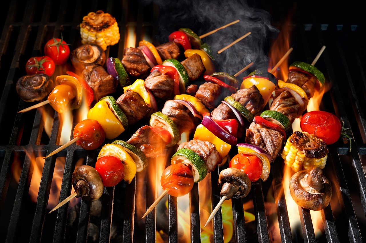 Barbecue-skewers-meat-kebabs-with-vegetables-on-flaming-grill