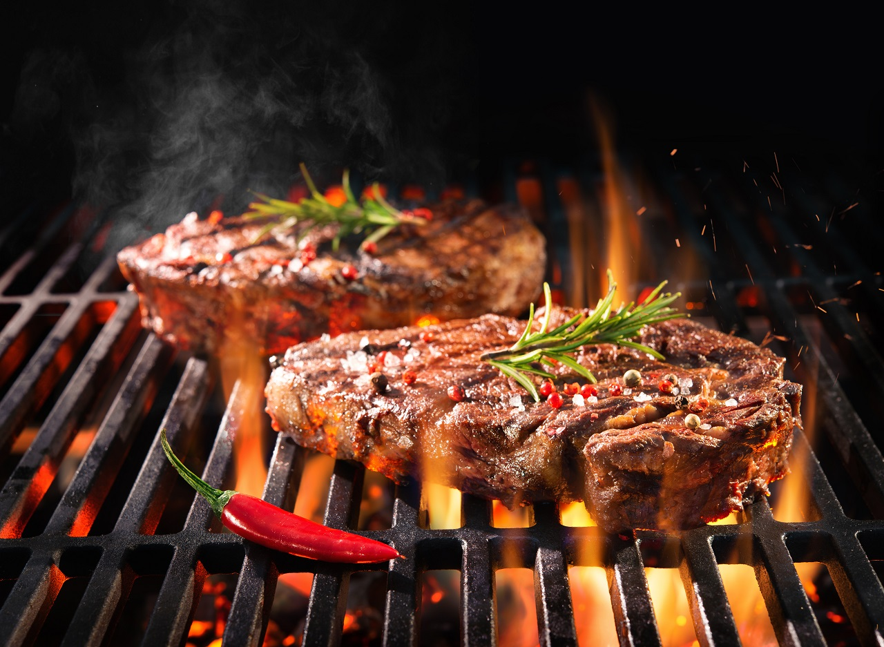 Beef-steaks-sizzling-on-the-grill-with-flames