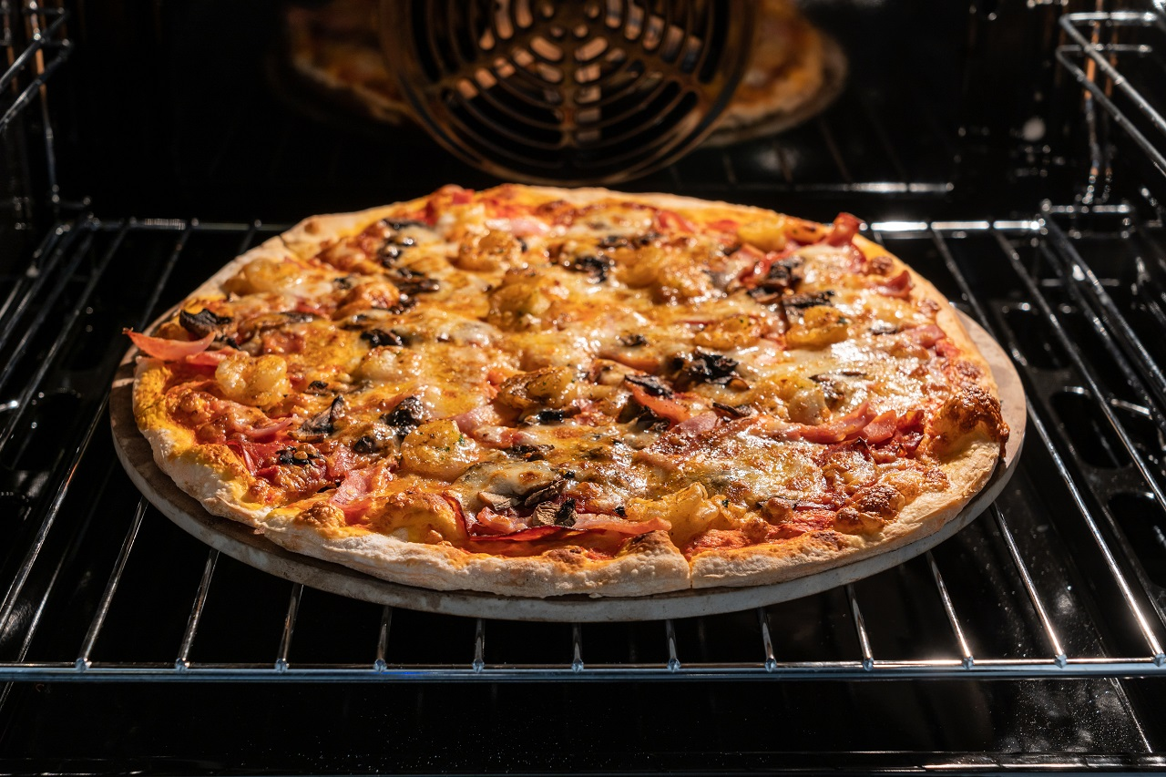 Homemade-pizza-is-baked-in-electric-oven