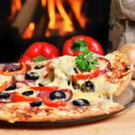 Pizza-lifting-slice-with-pepperoni-and-olives