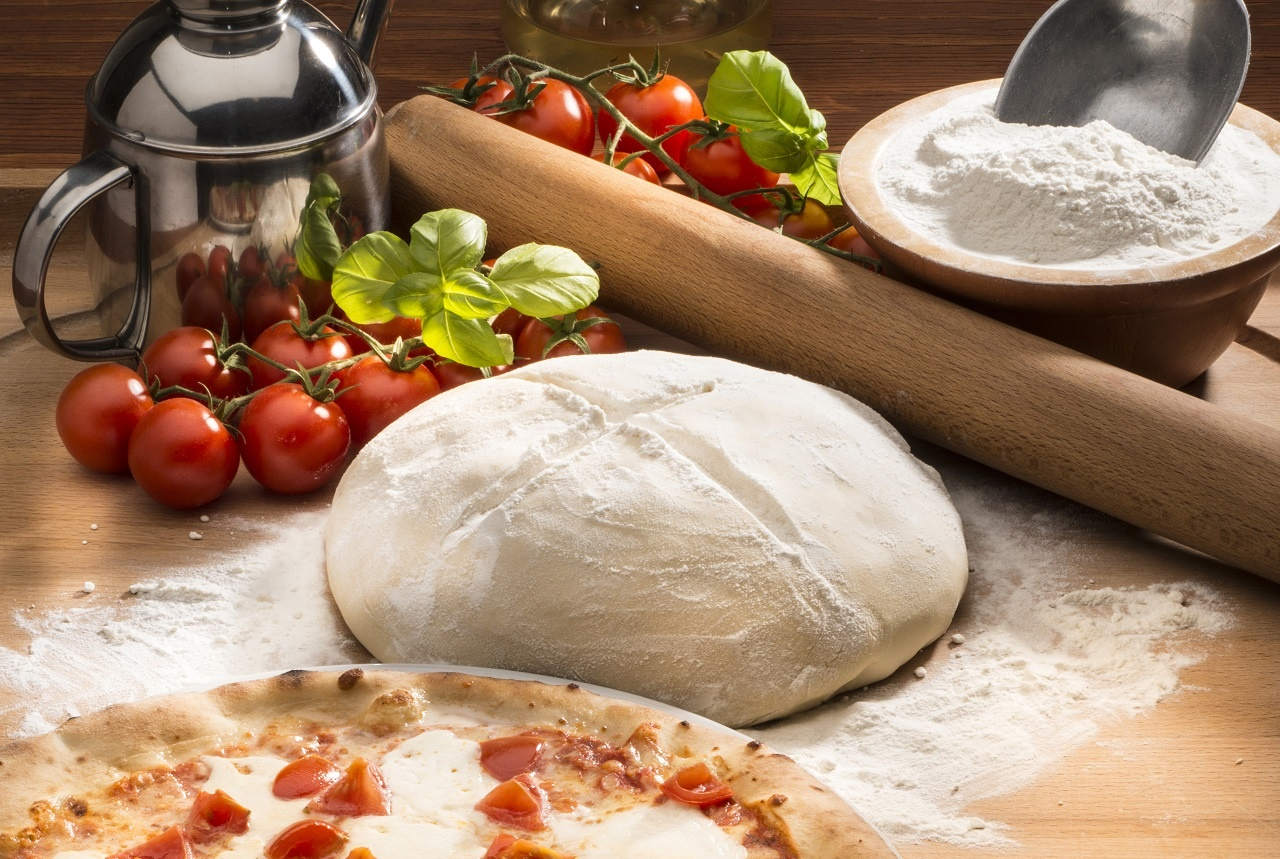pizza-with-ingredients-on-the-wooden-table