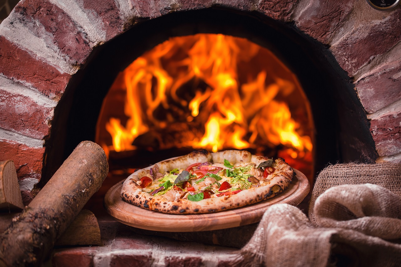 tasty-pizza-out-of-oven-in-restaurant-kitchen
