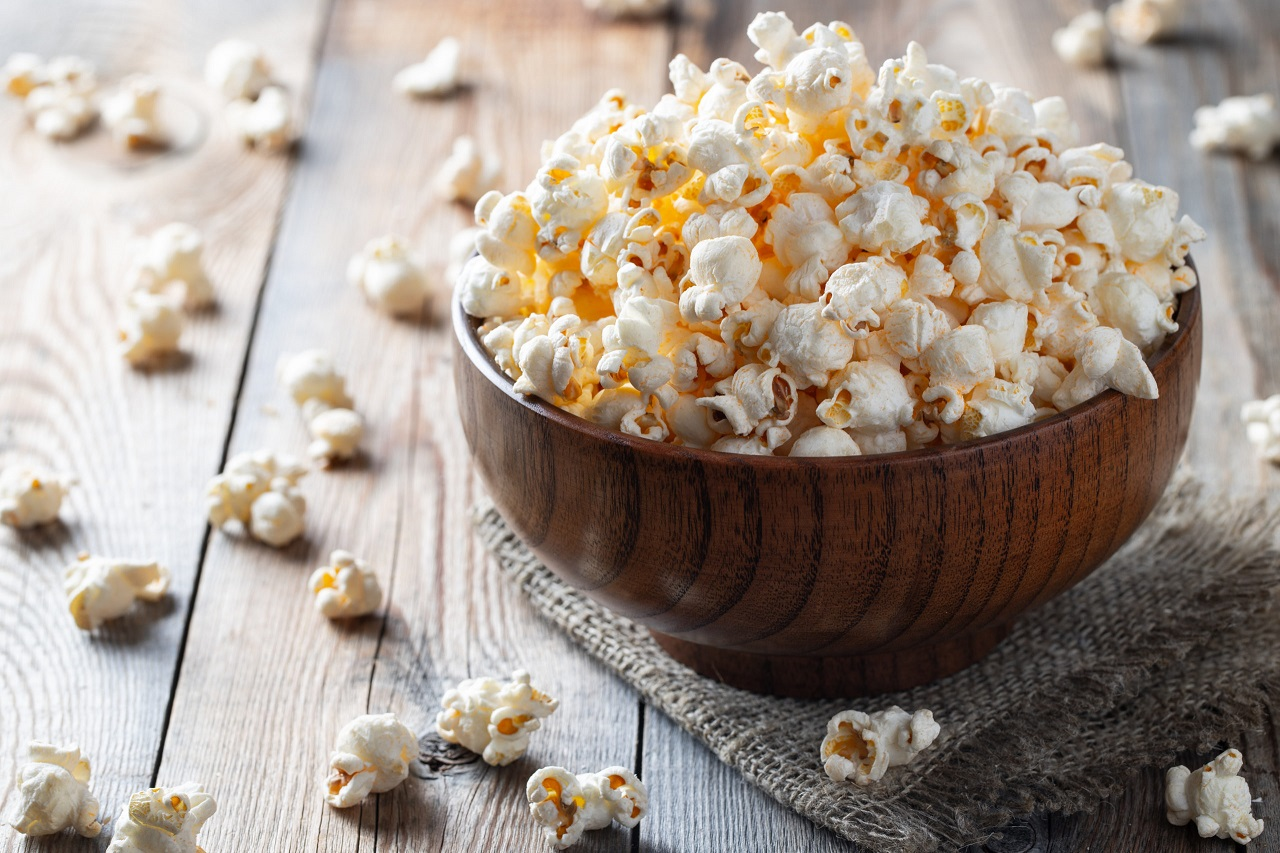 A-wooden-bowl-of-salted-popcorn-at-the-old-wooden-table