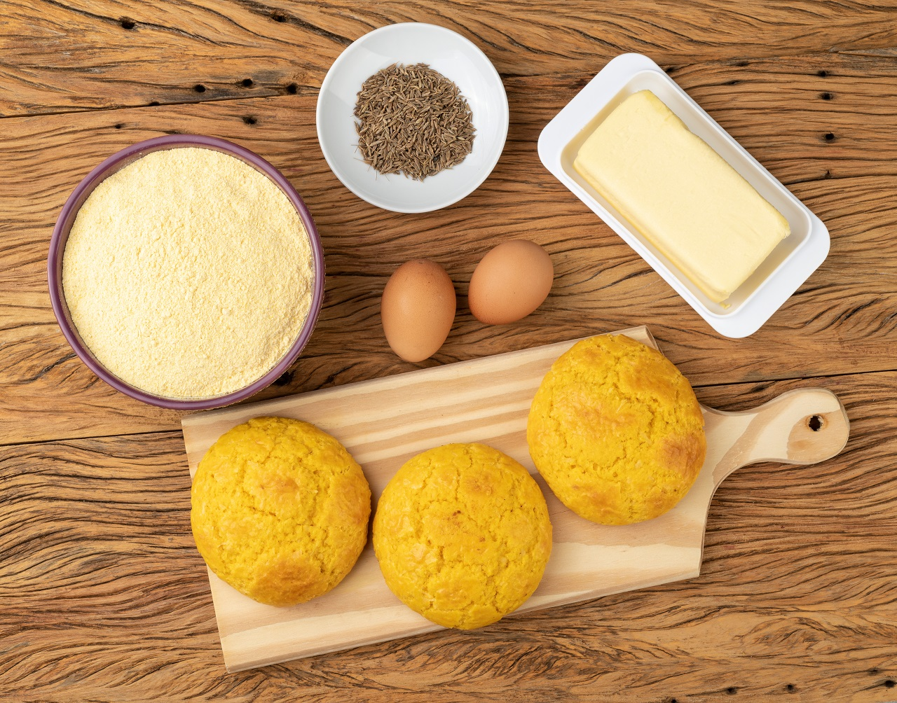 Broa-typical-brazilian-corn-flour-bread-with-ingredients.-Butter-eggs-herbs-and-fuba-corn-flour