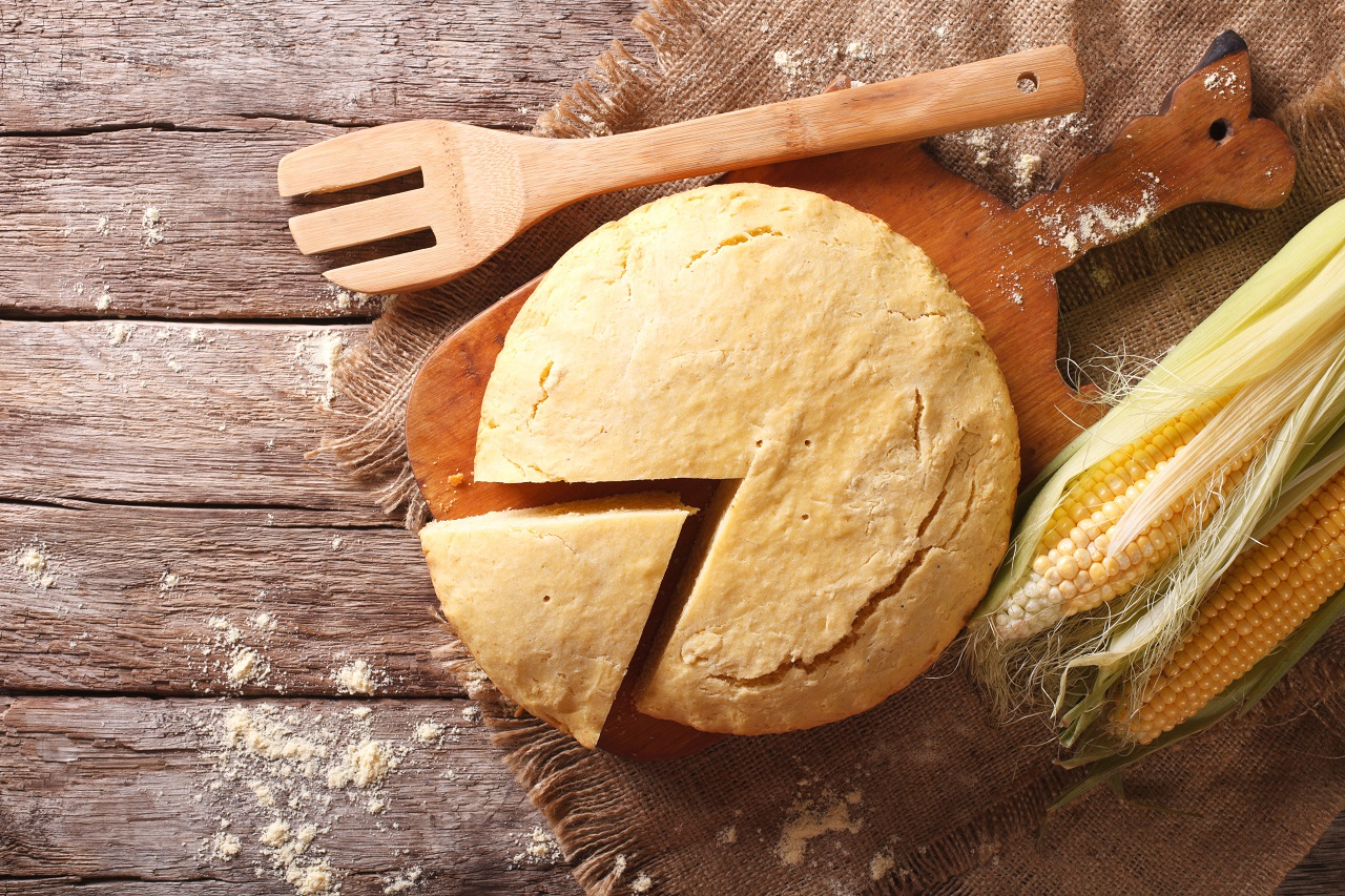 Delicious-freshly-baked-corn-bread-close-up-on-a-wooden-board