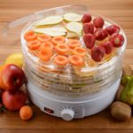 Food-dehydrator-and-fruits-on-a-wooden-table.-Special-equipment-for-drying-various-foods