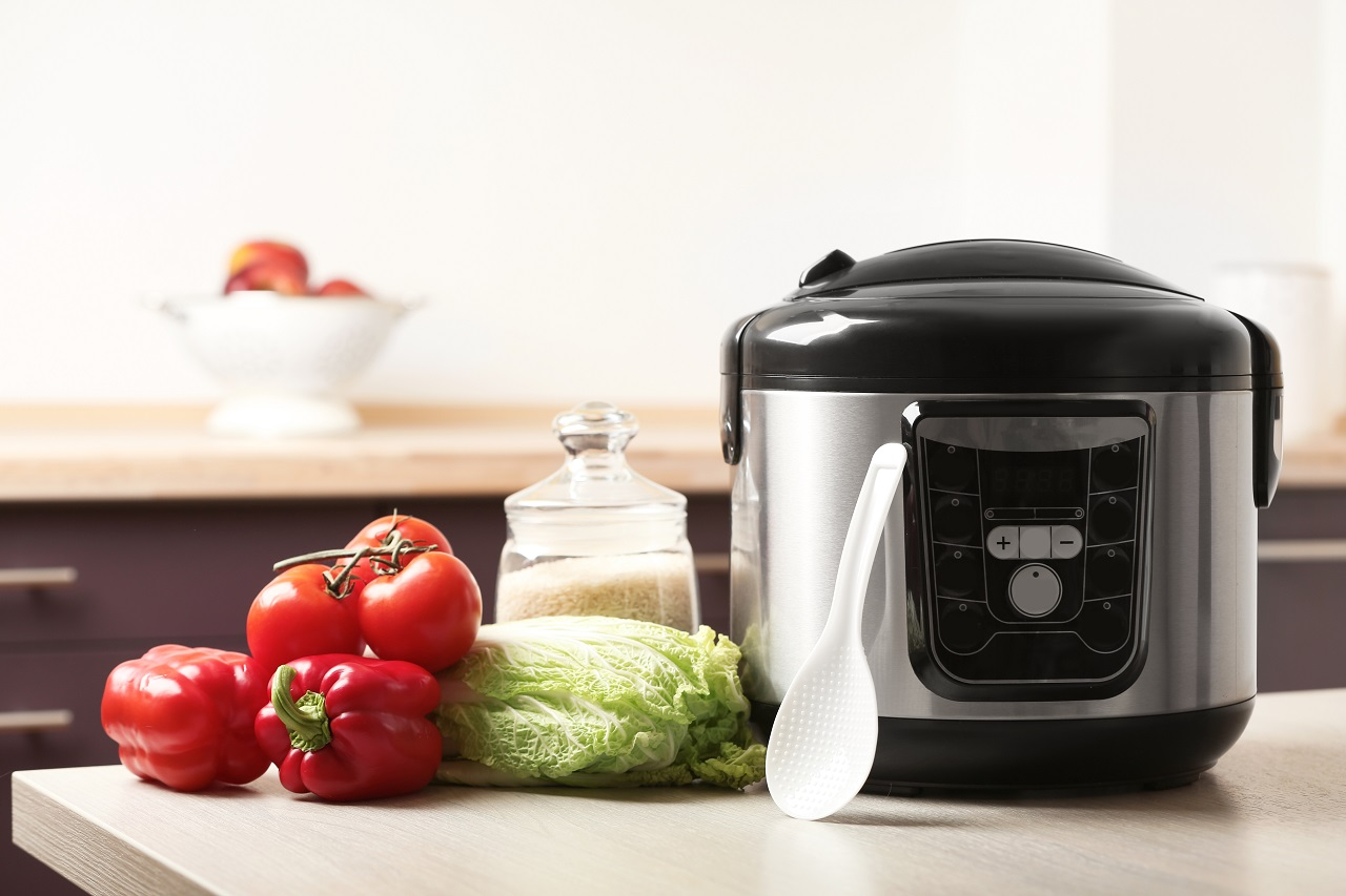 Modern-multi-cooker-and-products-on-table-in-kitchen