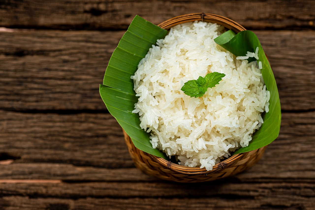 Sticky-rice-in-the-small-basket-with-wooden-backgrounders