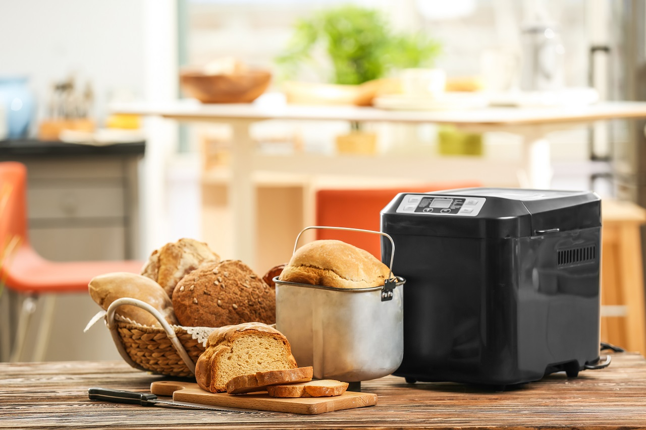 Tasty-sliced-loaf-and-bread-machine-on-table