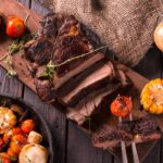 Grilled-Steak-sliced-on-a-cutting-board.-Meat-with-Grilled-Vegetables