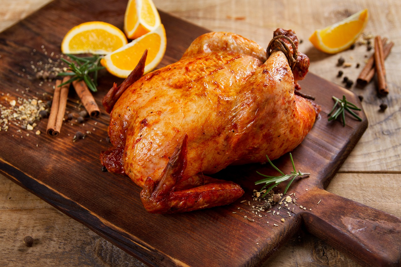 Roasted-chicken-with-spices-on-wooden-background-selective-focus.-Healthy-food-diet-or-cooking-concept