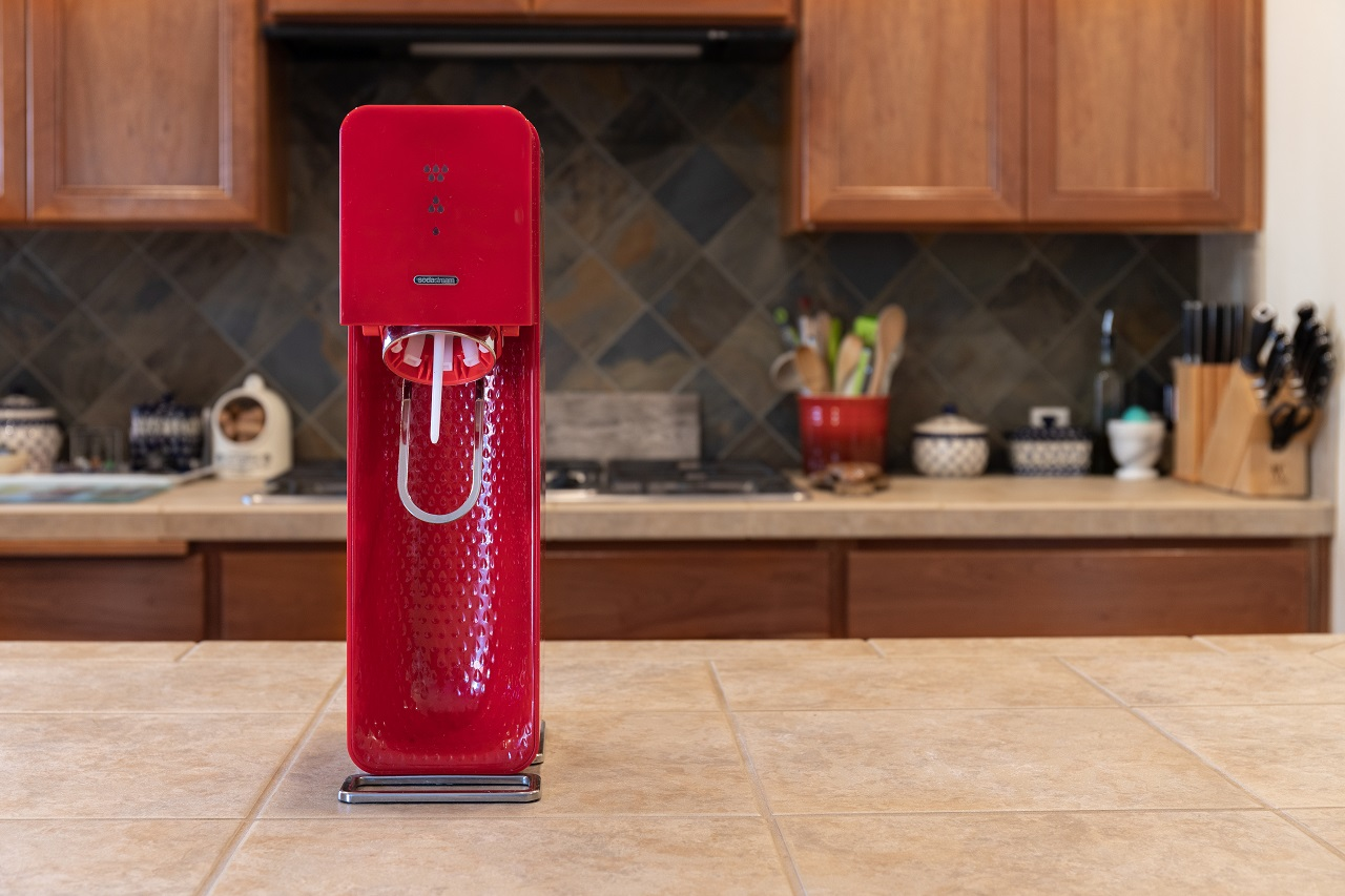Seattle-WAUSA-March-4-2020-Red-Sodastream-on-Countertop-with-Kitchen-Scene-in-Background